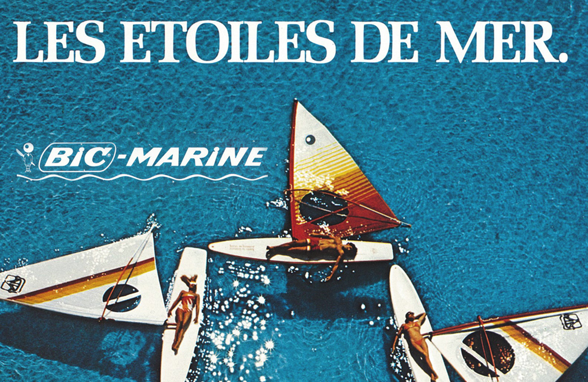 Ad for BIC Marine showing four windsurf boards on water