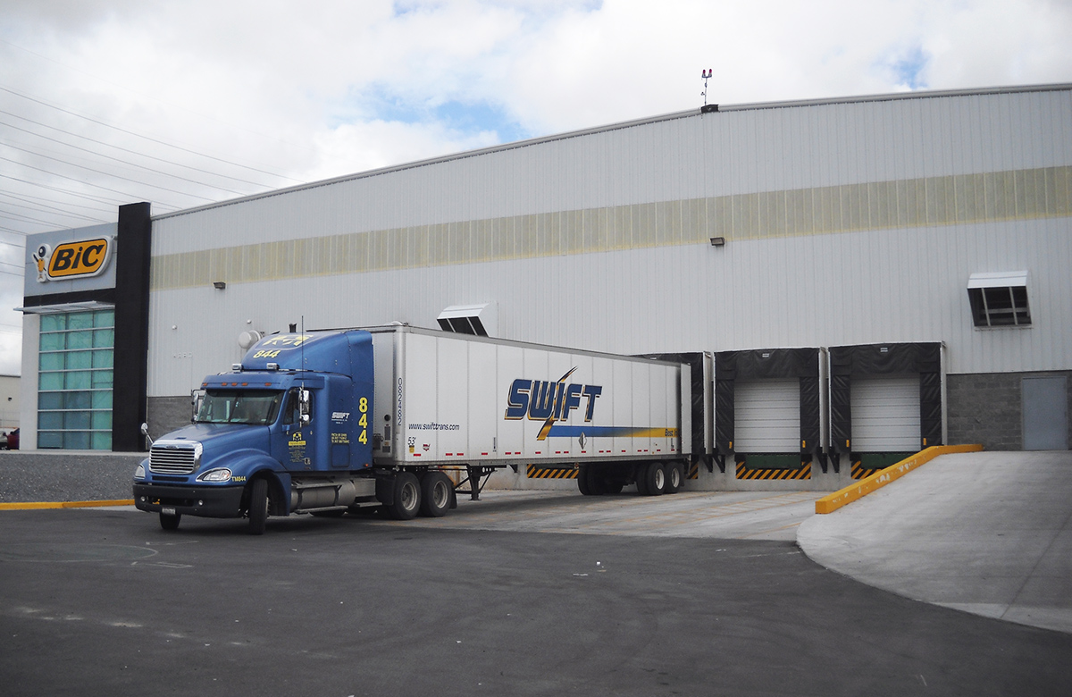truck leaving a factory in Mexico