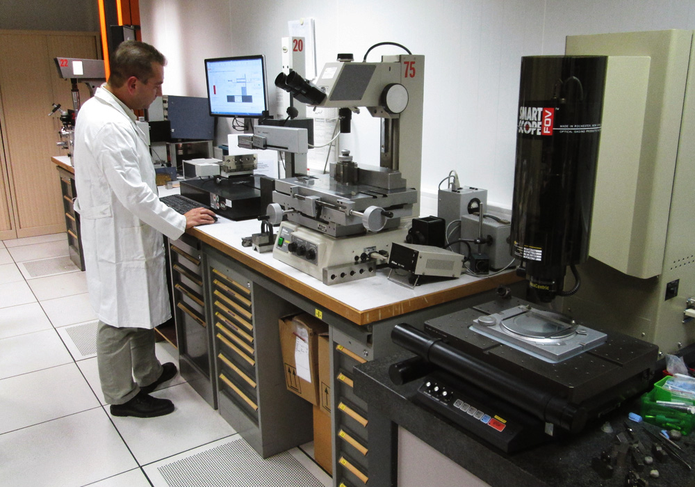 man in a lab with technical machines
