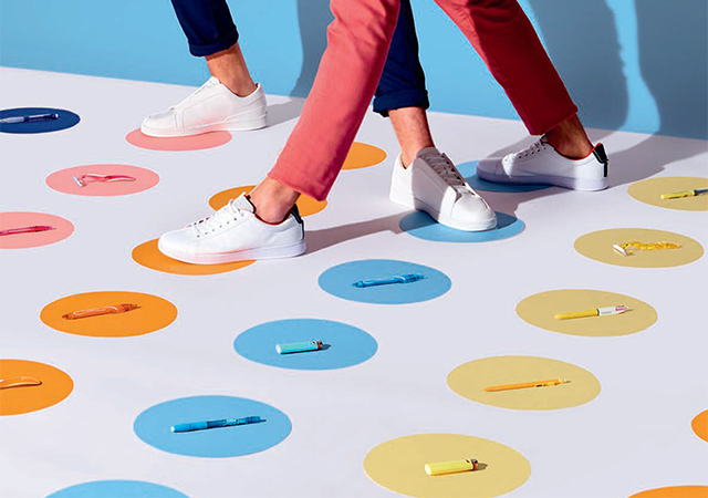 legs on a twister game with colored circles and bic products