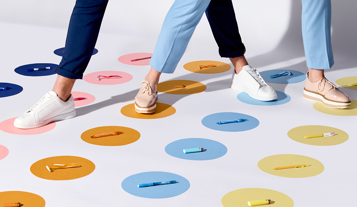 Legs on a twister game with colored rounds and products