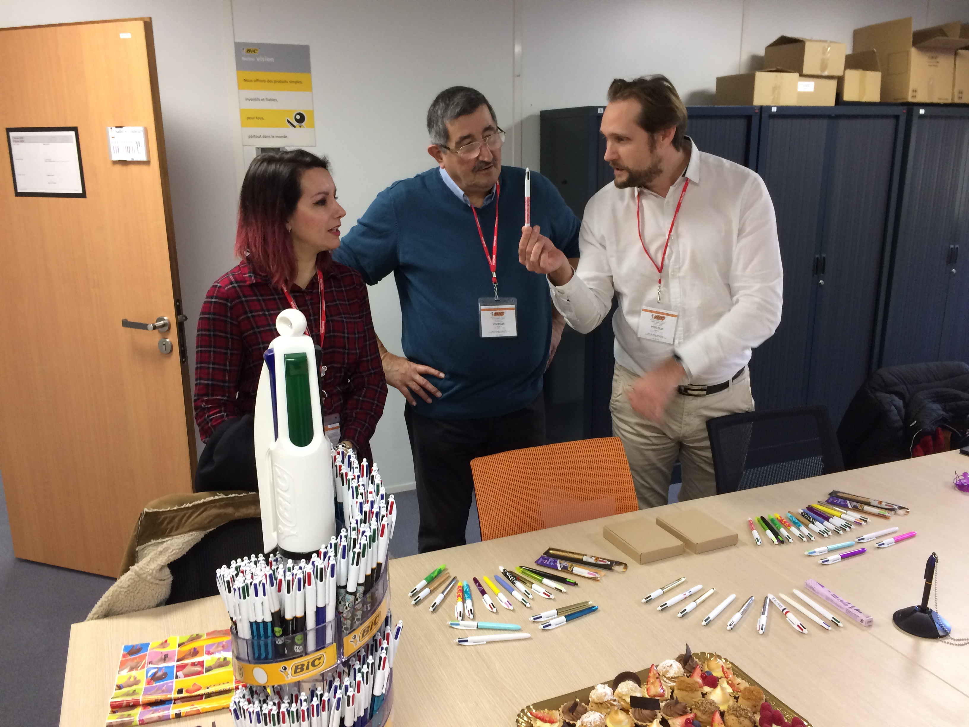 Celine and Patrick Dubois with BIC team member and display of 4-Color pens