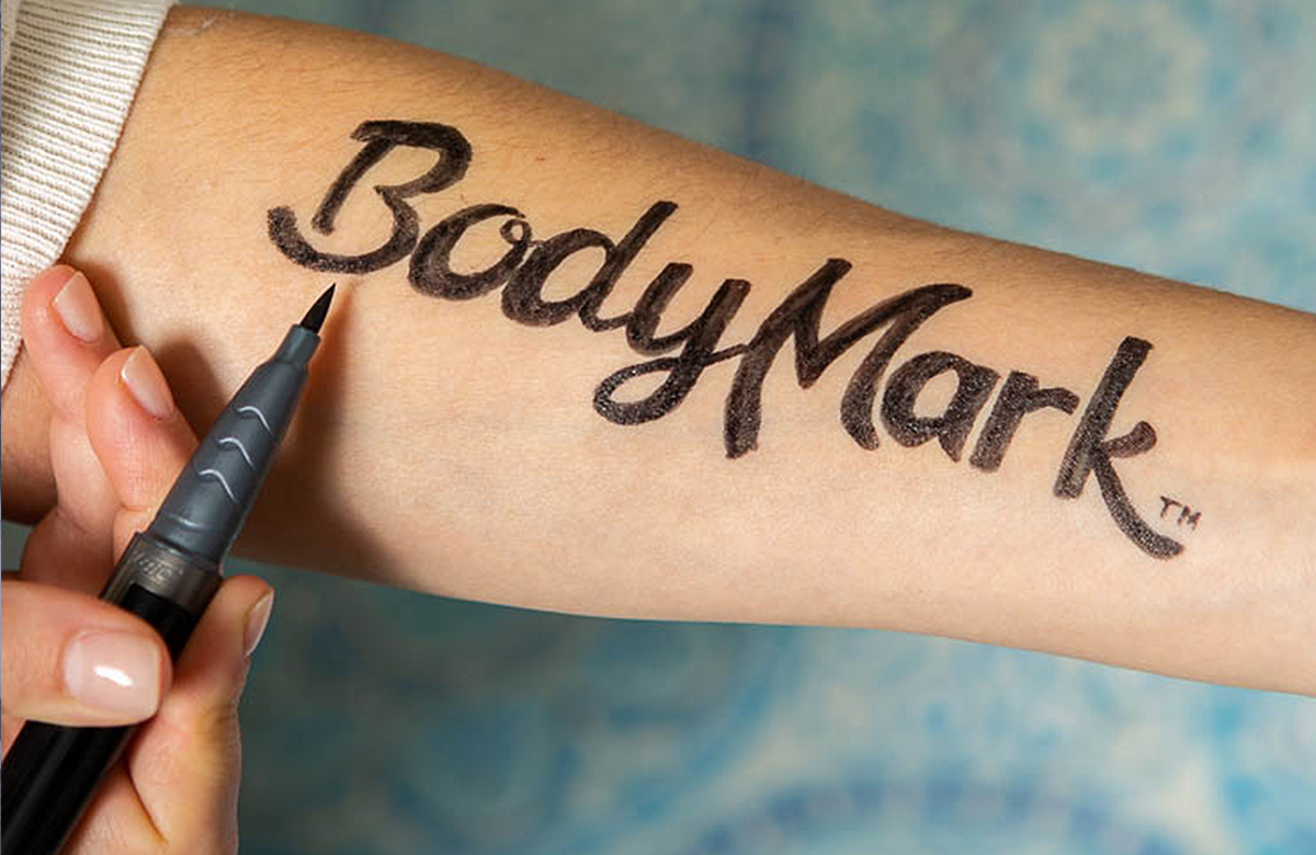 arm with BodyMark written on using BodyMark By BIC temporary tattoo markers