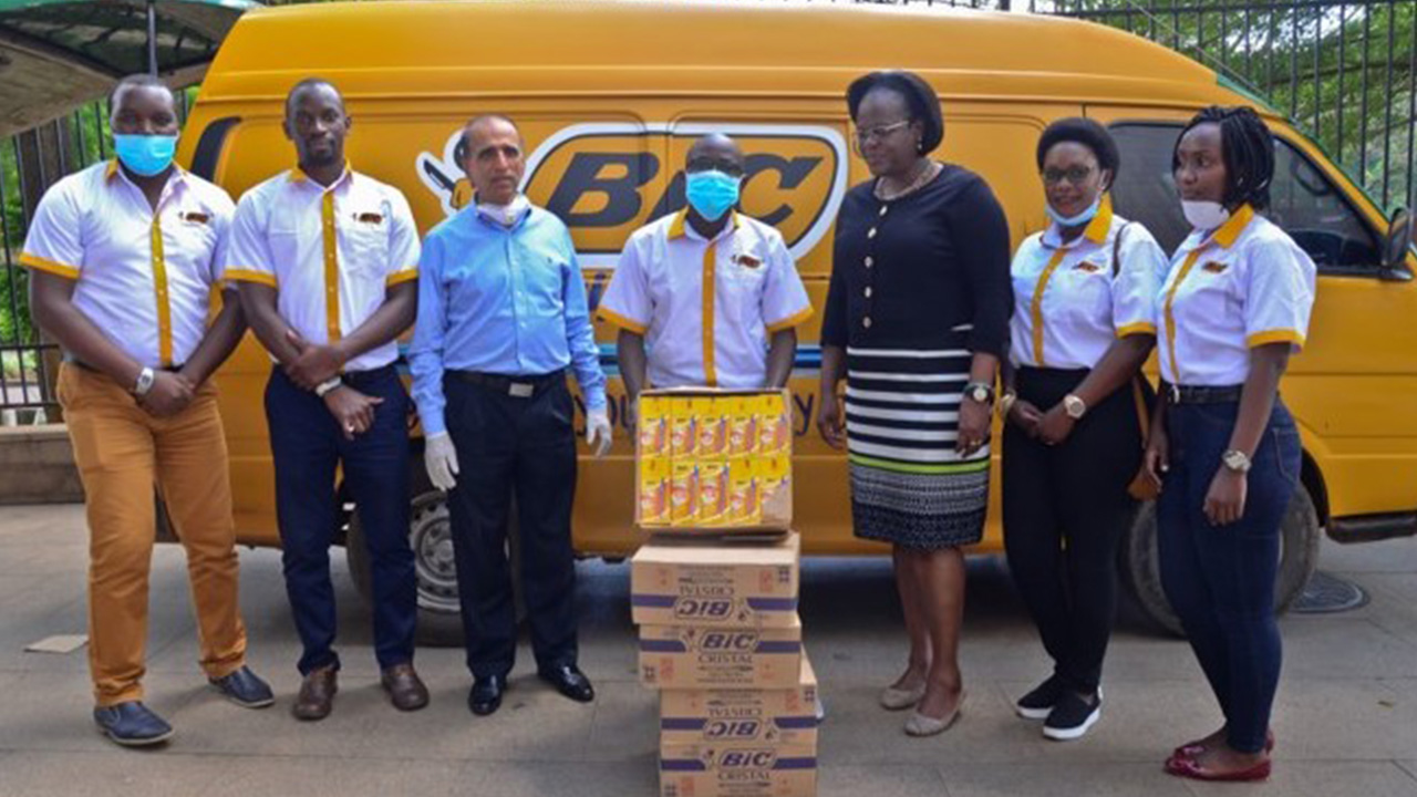 BIC team members with donated stationery items